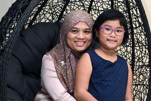 Left: Madam Noorliza, 43, a cervical cancer survivor. Above: With her daughter Farah Amirah Look Wei-En, now nine.