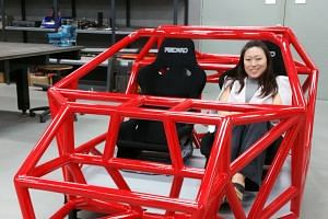 Vanda Electrics chief executive Larissa Tan seated in the space frame of the Vanda Dendrobium sports car. The car is named after an orchid because of the way its doors and roof open for easy access.