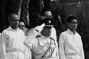 President Yusof Ishak, in military uniform, takes the salute at the Padang during Singapore's first National Day Parade in 1966. Mr Yusof, who died in office close to five decades ago, was Singapore's first and only Malay president so far.