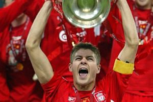 Above: The high point of Steven Gerrard's Liverpool career came when he lifted the Champions League trophy after the victory against AC Milan in Istanbul in 2005. Left: One of his greatest regrets was the failure to win an English top-flight title. T