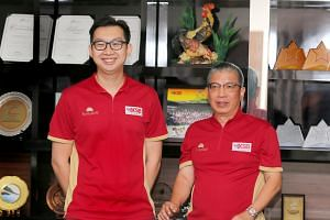 KSB Distribution sales manager Ong Guang Lin (left) and director Steven Tan. The poultry supplier's chicken-processing facility has been deploying two shifts daily in the run-up to the Chinese New Year festivities.