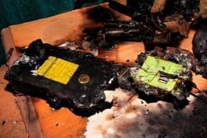 Close-up of a burnt e-bicycle battery following a fire last July. Investigations revealed that the fire was accidental in nature and of electrical origin. The e-bike's owner had left his bike charging for several hours in the living room. Last year,