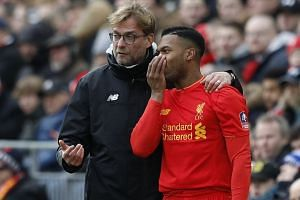 Jurgen Klopp instructing Daniel Sturridge before sending him on as a substitute in the FA Cup fourth-round loss to Wolves. Illness and inconsistent form have limited the forward's chances at Liverpool this season.