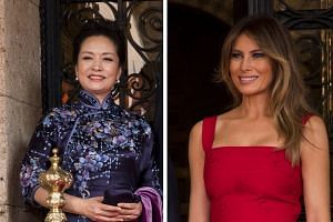 Ms Peng Liyuan and Mrs Melania Trump arriving at Palm Beach International Airport in Florida on Thursday. The First Ladies both later wore dresses that matched their husbands' tie colour at the Mar-a-Lago resort in Palm Beach, Florida.