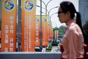 Banners on display along a street on Tuesday, ahead of the Belt and Road Forum for International Cooperation in Beijing on Sunday. China is hosting the summit to showcase its ambitious drive to revive ancient Silk Road trade routes and lead a new era