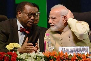 African Development Bank president Akinwumi Adesina and Indian Prime Minister Narendra Modi at the bank's meeting, the first major meeting of its kind between India and Africa since 2015.