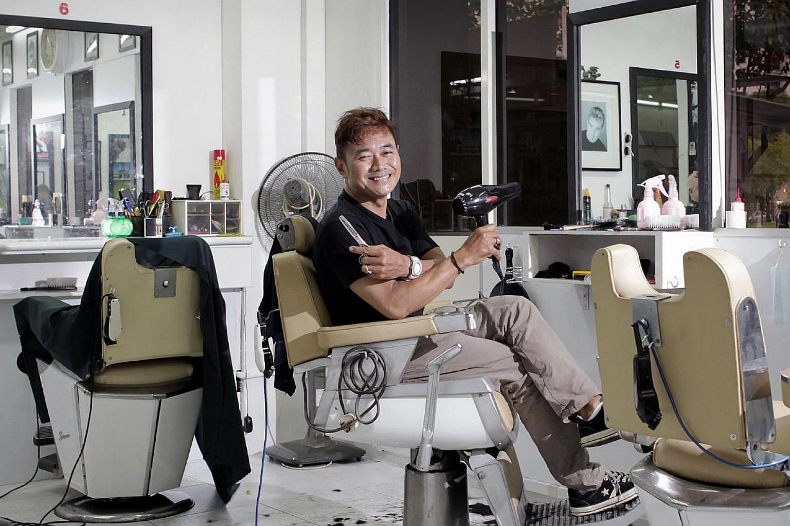 Mr Juffri Hanan, a Malay barber who owns a shop at Rivervale Plaza in Sengkang, goes to various secondary schools to cut students' hair on the request of their discipline masters. -- ST PHOTO: NEO XIAOBIN