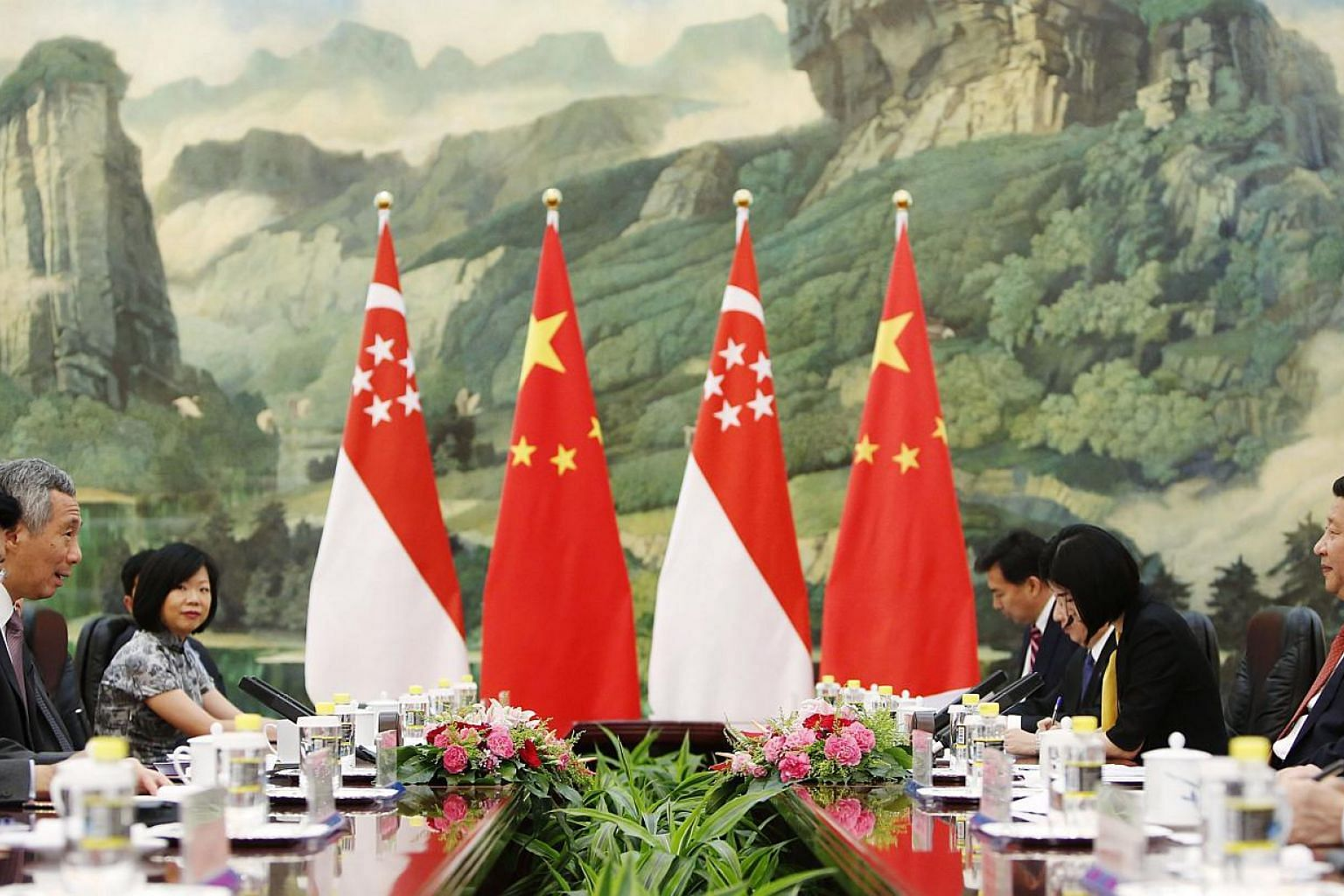 PM Lee and Chinese President Xi Jinping (right) at their meeting in Beijing yesterday. Also present were Senior Minister of State for Trade and Industry and National Development Lee Yi Shyan (left) and Senior Parliamentary Secretary for Communication