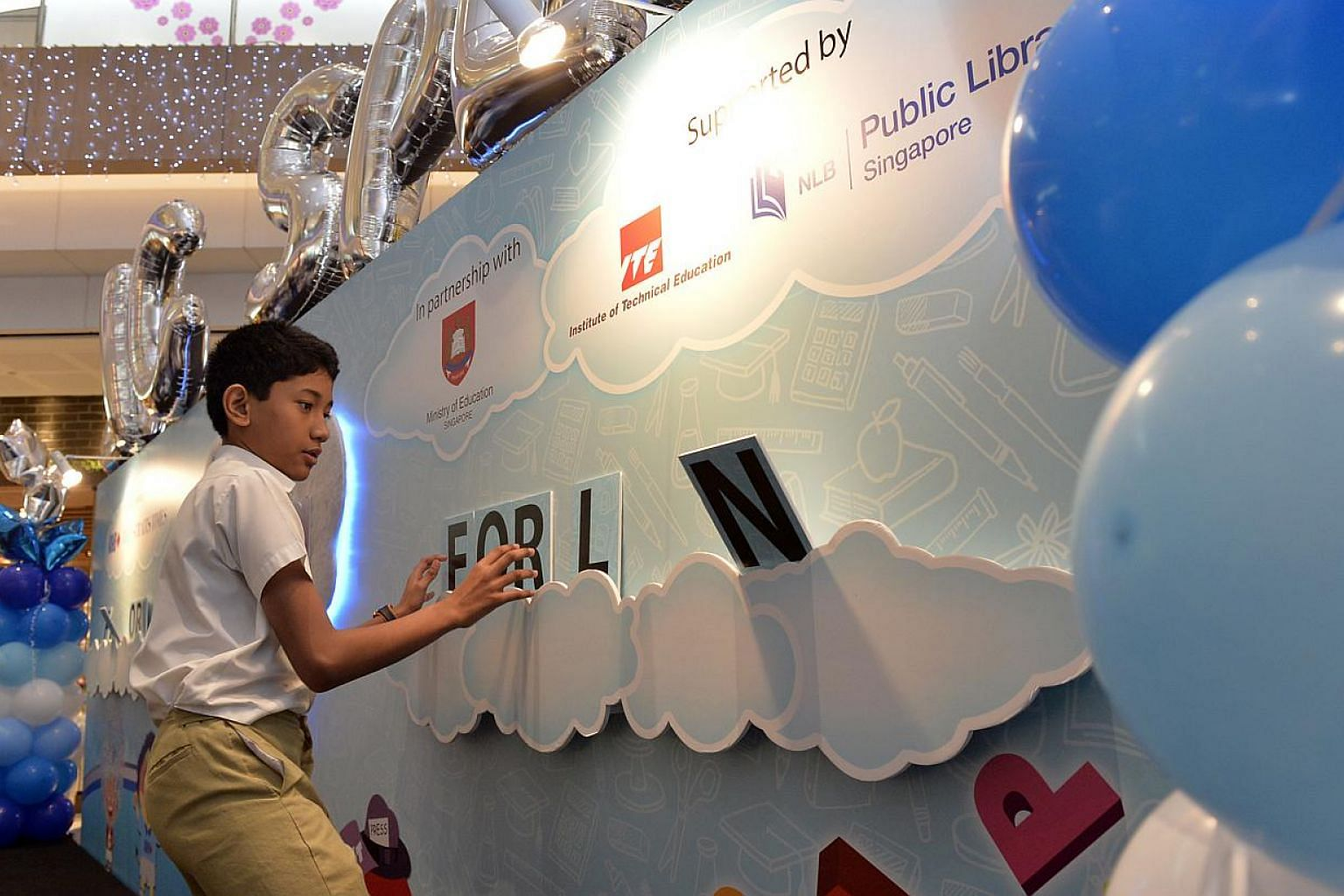 The launch of the RHB-The Straits Times National Spelling Championship (NSC) at Westgate Mall in Jurong East on Saturday, Jan 25, 2014. Spelling fever is set to reach a wider audience this year. -- ST PHOTO: DESMOND FOO