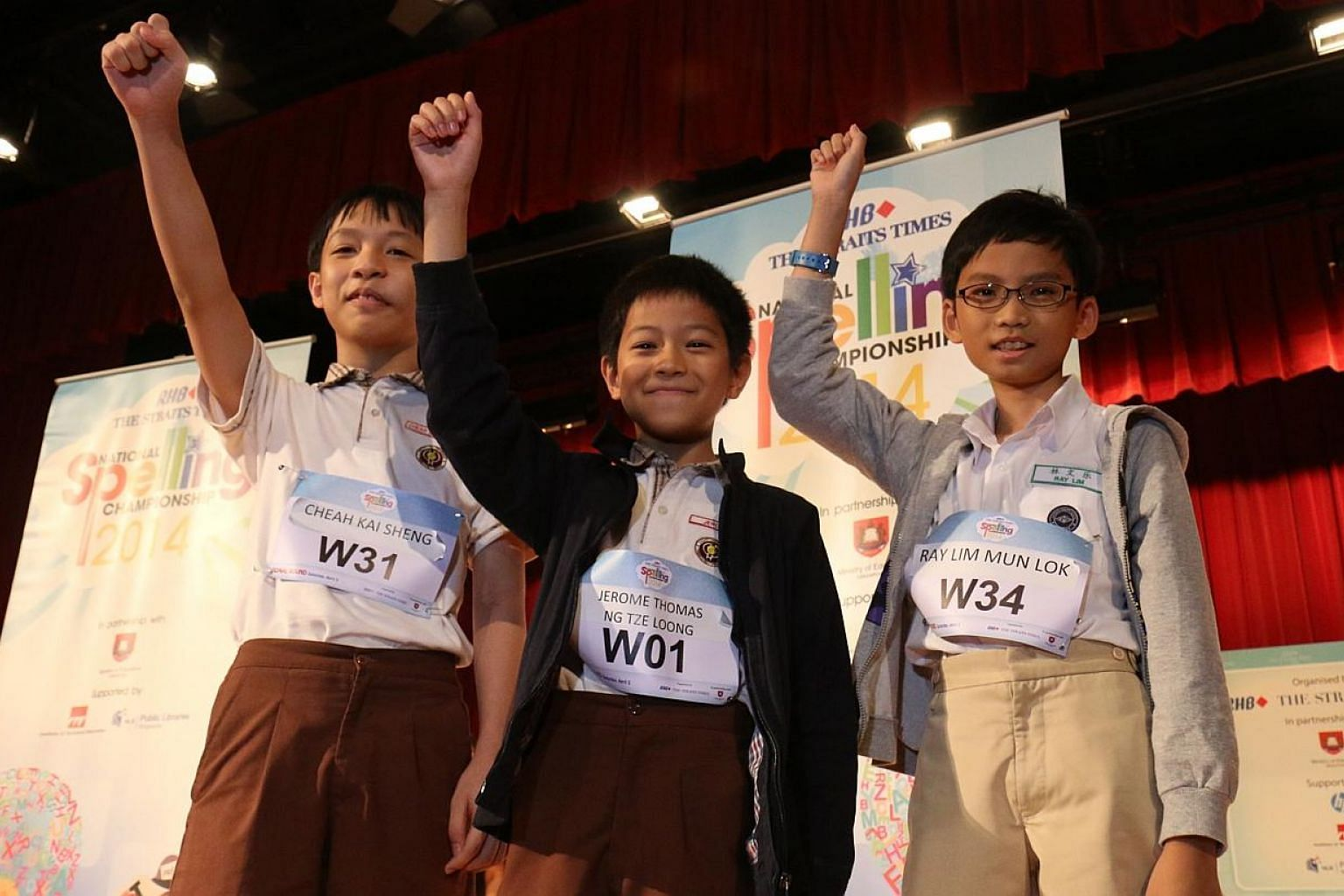 (From left) Cheah Kai Sheng, 12, and Jerome Ng,10, both from Henry Park Primary School, and Ray Lim, 10, from Nanyang Primary School, were crowned 2nd runner-up, champion and 1st runner-up respectively at the RHB-The Straits Times National Spelling C