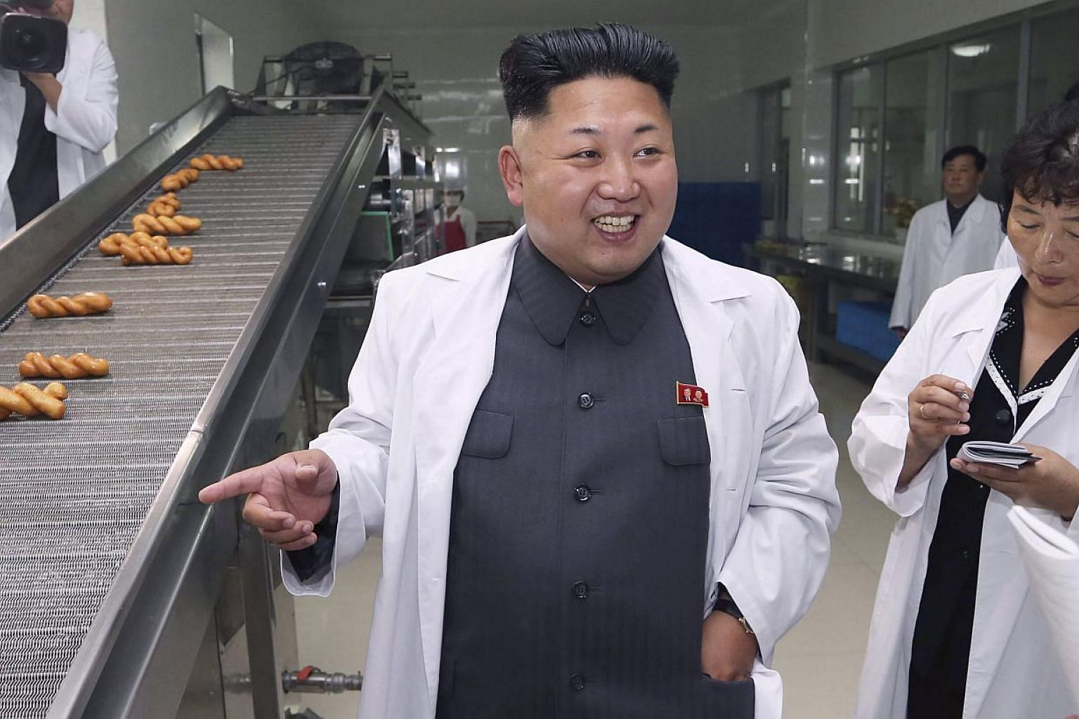 North Korean leader Kim Jong Un smiles as he gives field guidance during a visit to the November 2 Factory of the Korean People's Army (KPA). -- PHOTO: REUTERS