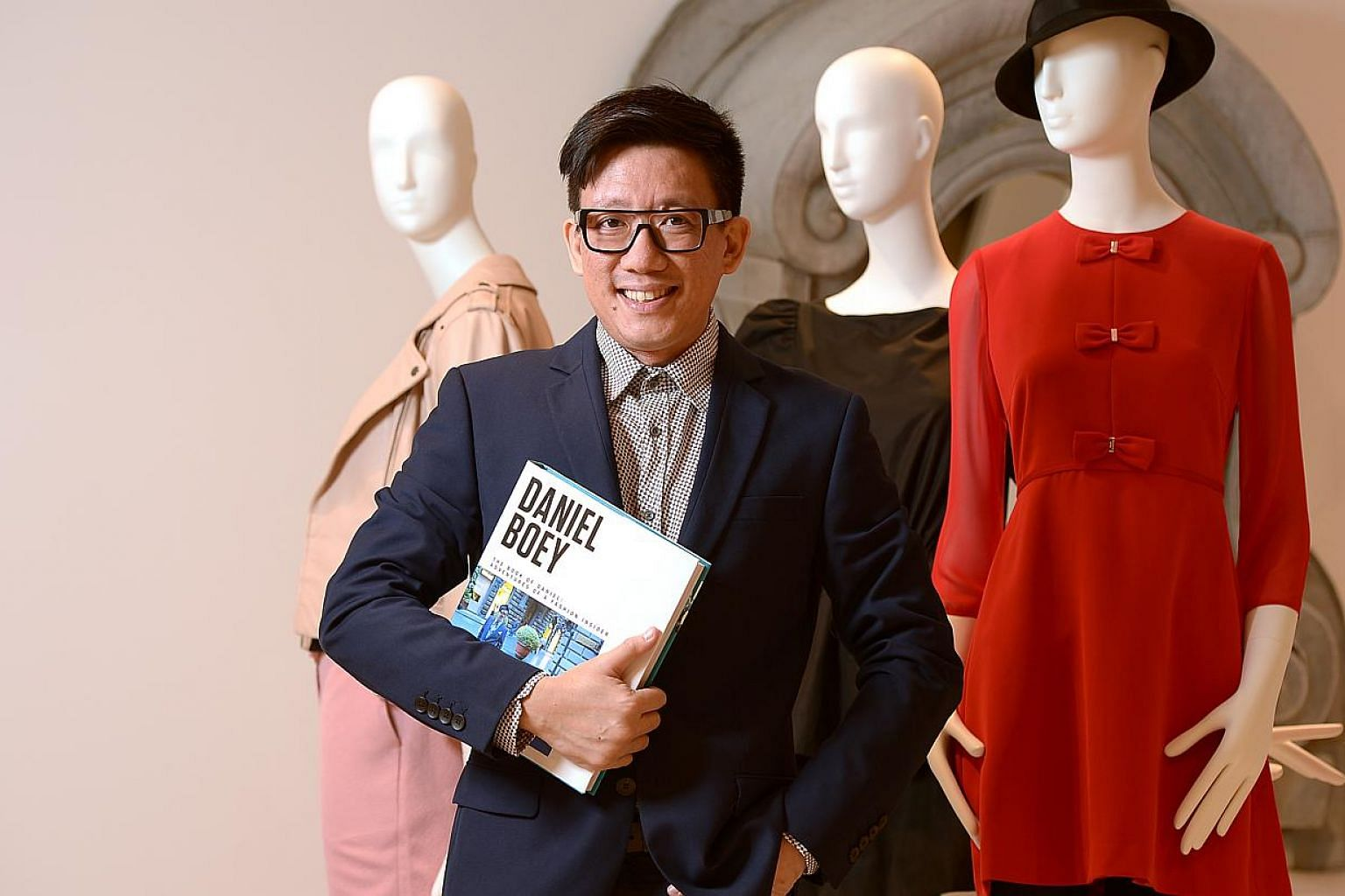 Daniel Boey's new autobiography is called The Book Of Daniel: Adventures Of A Fashion Insider. -- ST PHOTO: DESMOND WEE