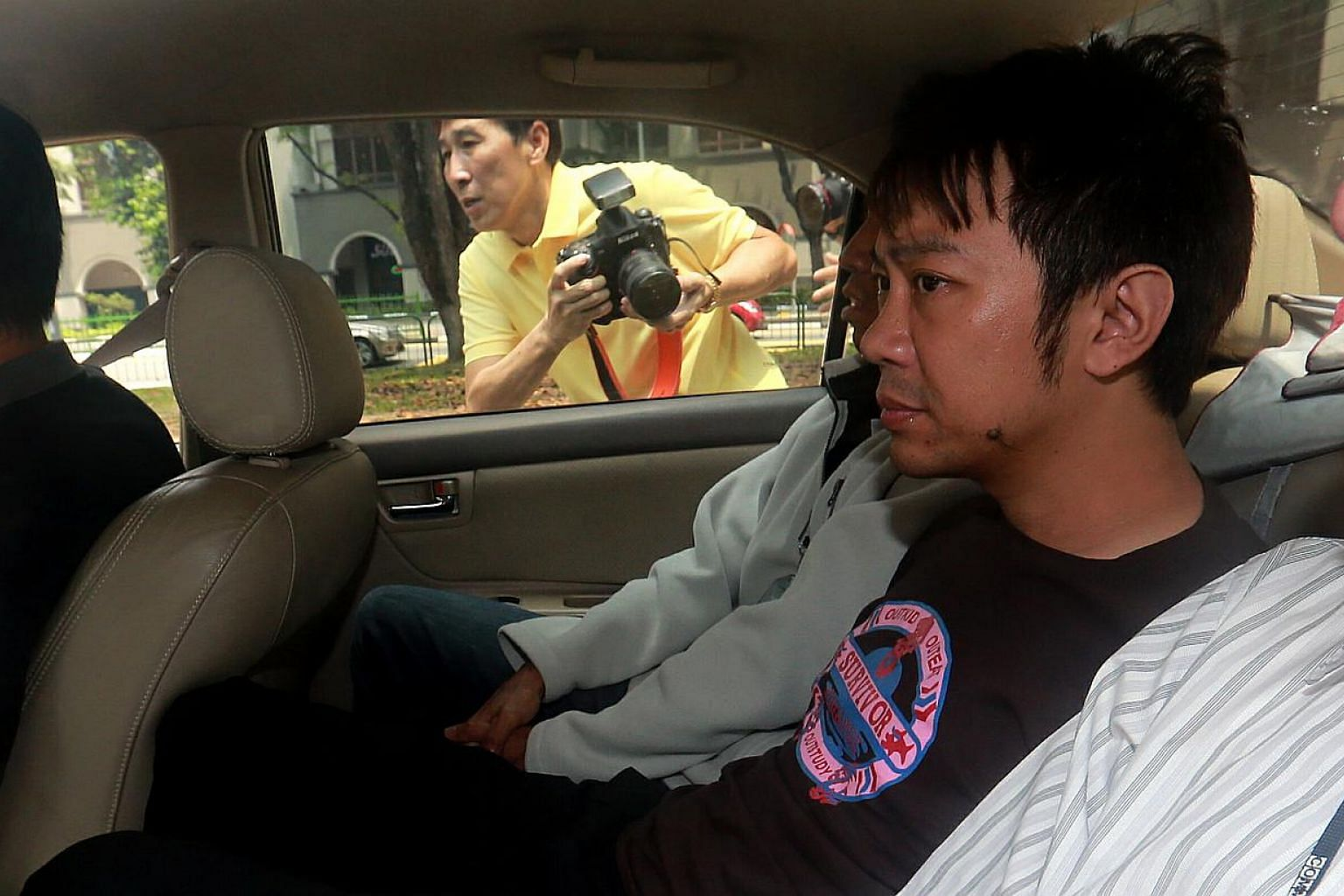 Former China tour guide Yang Yin has been remanded while the High Court deliberates over whether to reverse an earlier decision to grant him bail. -- ST PHOTO: WONG KWAI CHOW