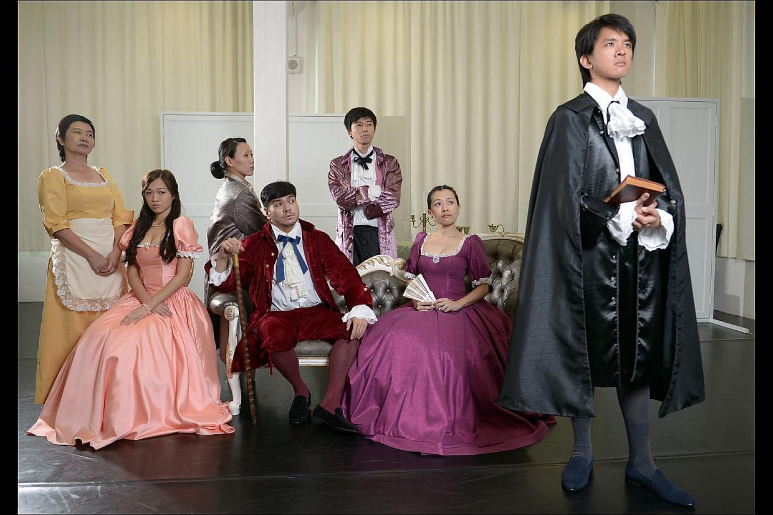 The cast of Tartuffe at a dress rehearsal (from far left) Jalyn Han, Jean Toh, Koh Wan Ching, Darius Tan, Neo Hai Bin, Mia Chee and Hang Qian Chou. -- ST PHOTO: DESMOND WEE