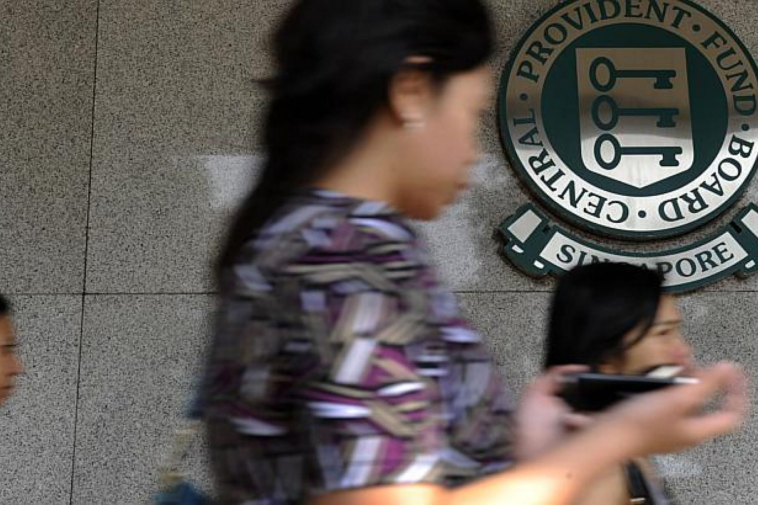 Central Provident Fund (CPF) members should be able to withdraw up to 20 per cent of their savings when they become eligible for monthly payouts at 65, the panel reviewing the scheme has recommended. -- PHOTO: ST FILE