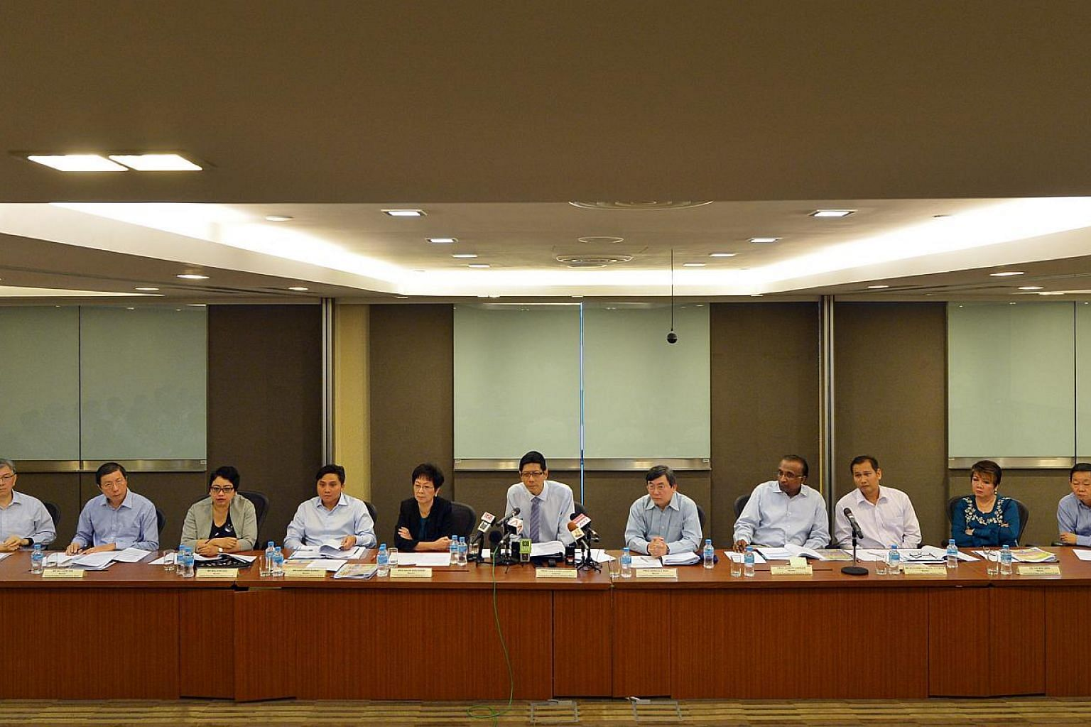 The CPF Advisory Panel holding its press conference to announce recommendations on how to make the CPF system more flexible on Feb 4, 2015, at the Ministry of Manpower. -- ST PHOTO: ALPHONSUS CHERN