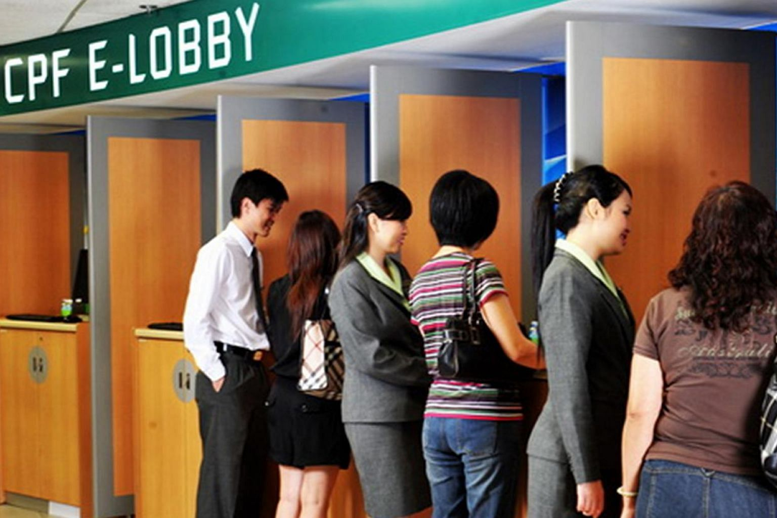 File photo of people at the CPF E-Lobby. --PHOTO: CPF