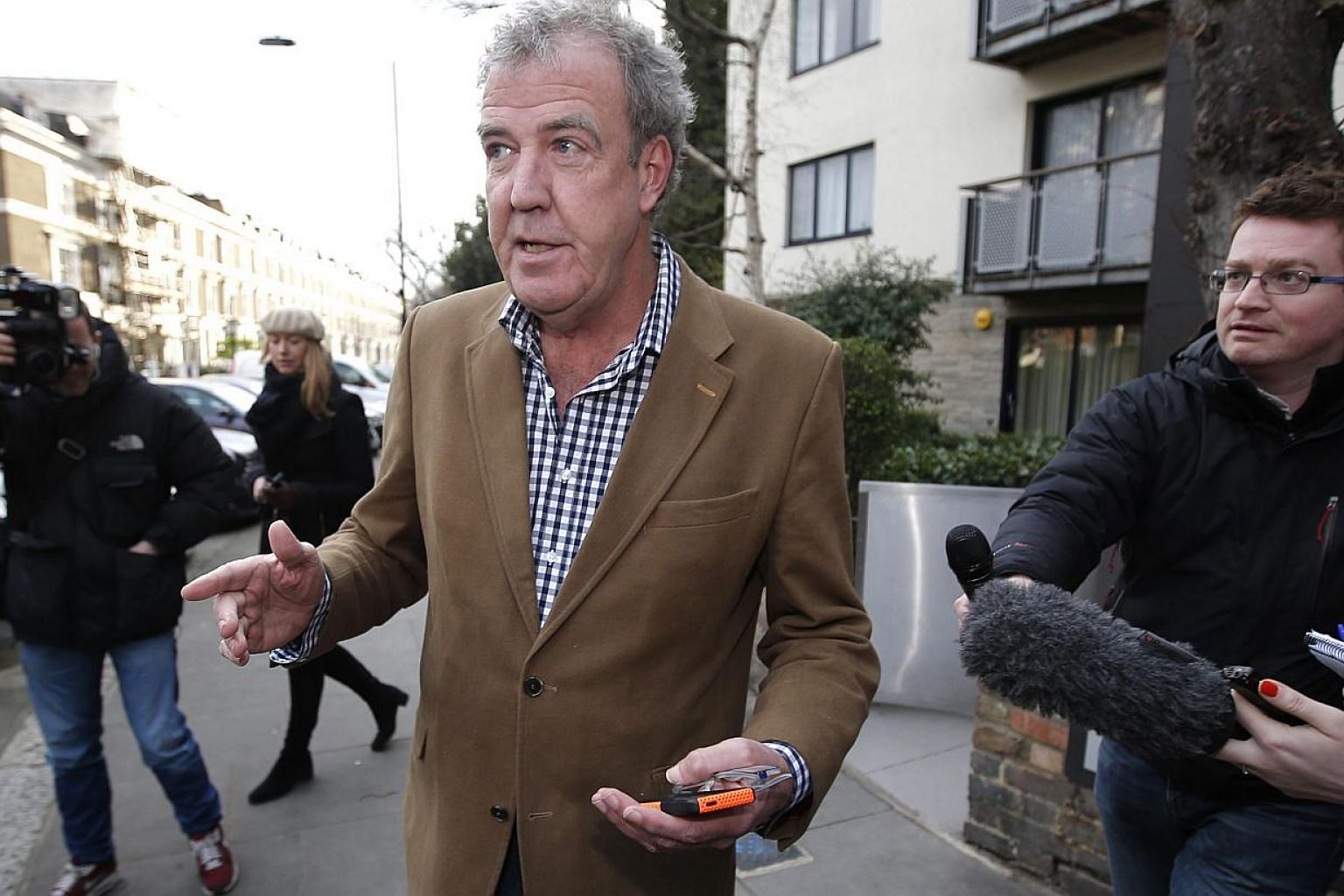British television presenter Jeremy Clarkson leaves his home in London March 24, 2015.Clarkson will continue to appear on an international tour of live auto shows despite being dropped as the presenter of hit series Top Gear, the BBC said on Tu