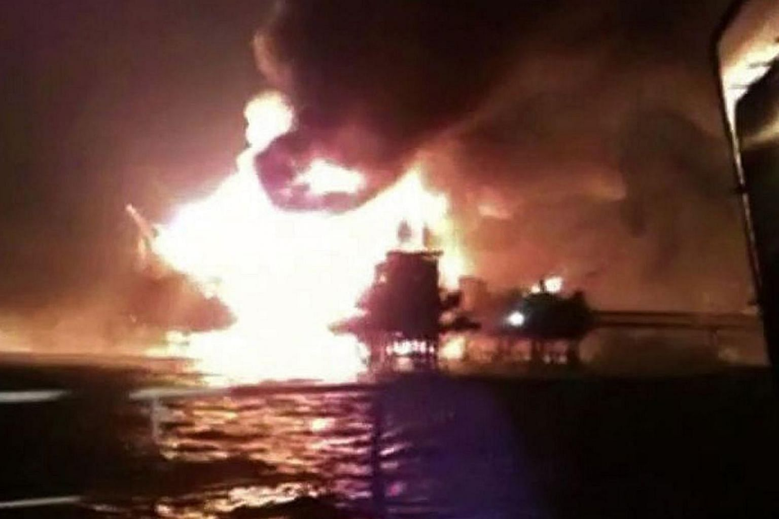 A screengrab from a video of the Abkatun A-Permanente platform on the Gulf of Mexico's Campeche Sound on fire on April 1, 2015. An explosion and a fire erupted on an offshore oil platform operated by Mexico's Pemex on Wednesday, killing at least four