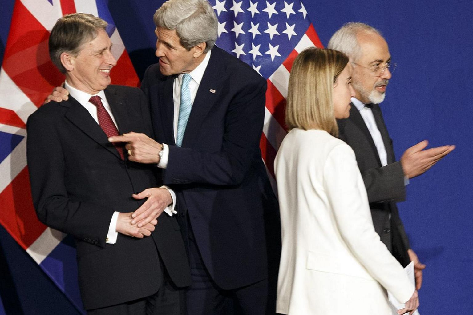 (From left) British Foreign Secretary Philip Hammond, US Secretary of State John Kerry, EU High Representative for Foreign Affairs and Security Policy Federica Mogherini and Iranian Foreign Minister Mohammad Javad Zarif react during a press event aft