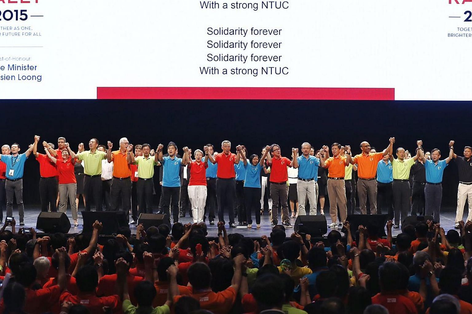 Ministers and union leaders singing during the May Day celebration at the May Day Rally on May 1, 2015.-- PHOTO: KEVIN LIM