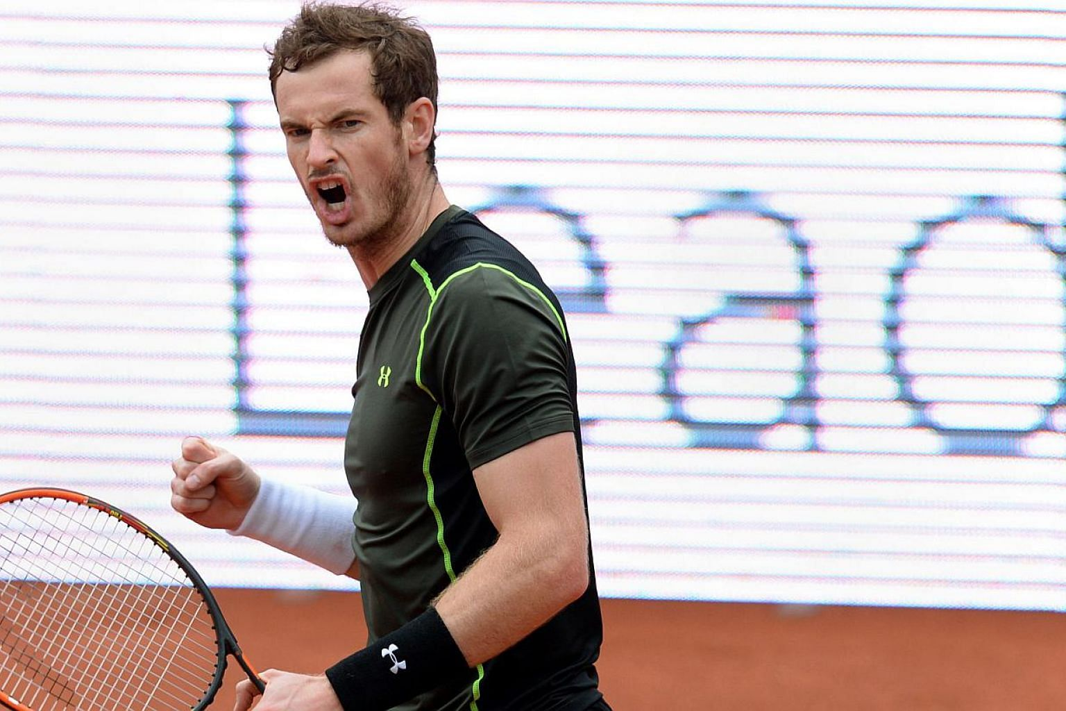Britain's Andy Murray celebrates after his quarter-final match against Lukas Rosol of Czech Republic at the ATP Tennis Open in Munich, southern Germany, on May 2, 2015. Murray won the match 4-6, 6-3 and 6-2. -- PHOTO: AFP