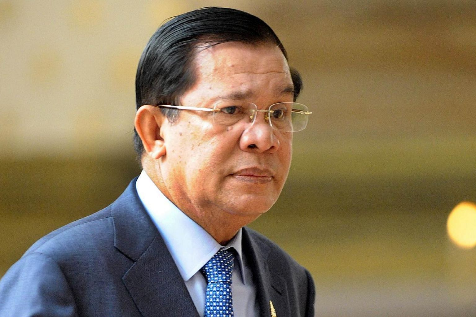 Hun Sen said he had made a US$5,000 bet with an official on the match outcome, a bet he would no longer honour.-- PHOTO: AFP
