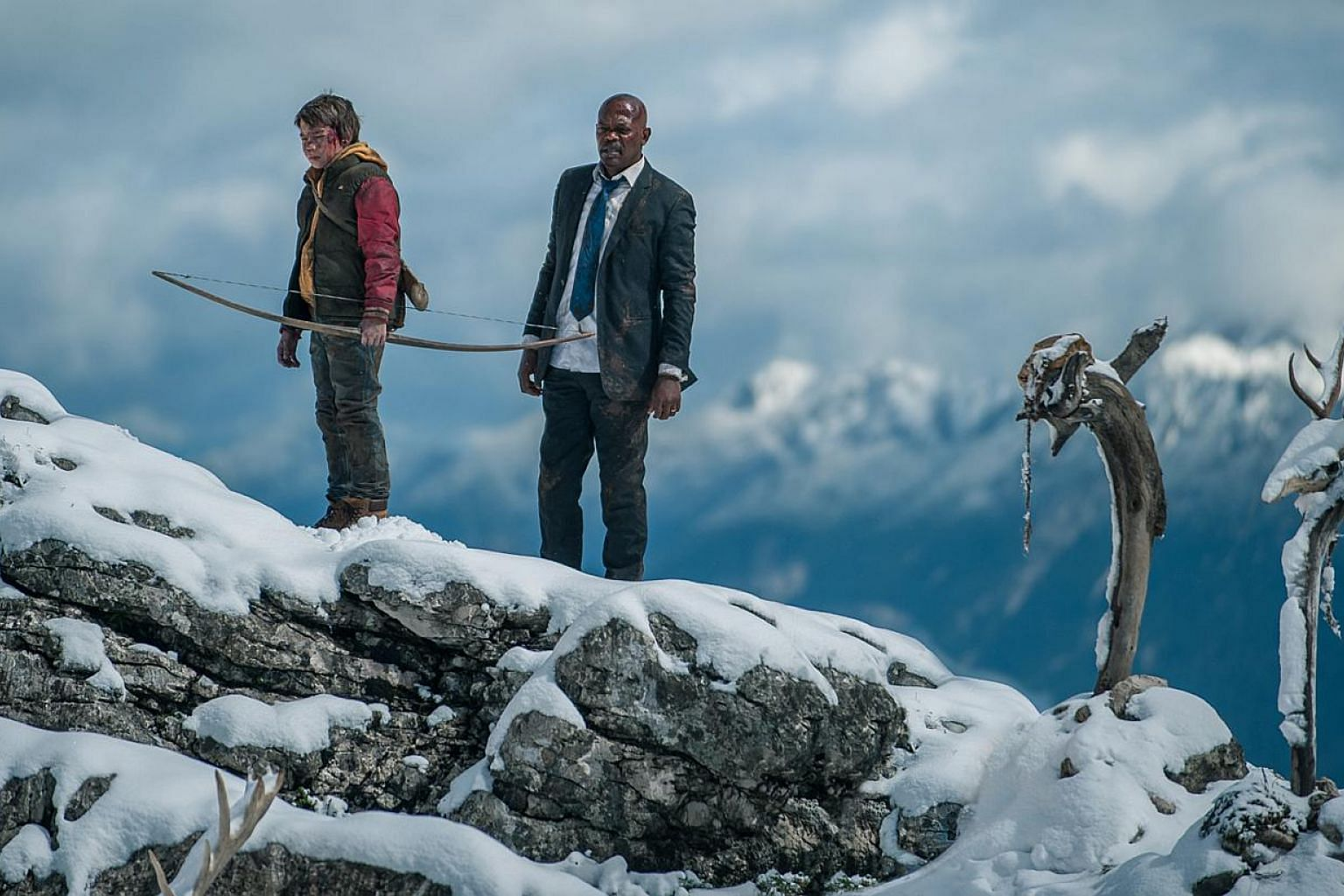 Onni Tommila (left) as the 13-year-old who stumbles upon the American president (Samuel L. Jackson, right) in the Finnish forest and has to keep him safe. -- PHOTO: GOLDEN VILLAGE PICTURES