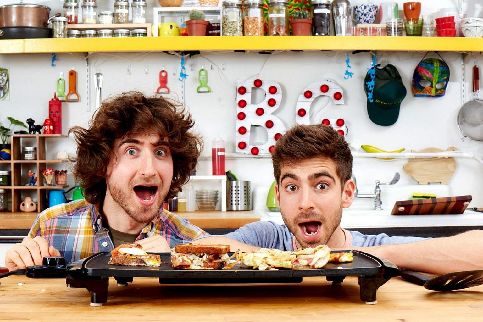 Josh (far left) and Mike Greenfield got their new TV show after their tutorial videos of easy-to-cook meals on YouTube caught the attention of a production house.