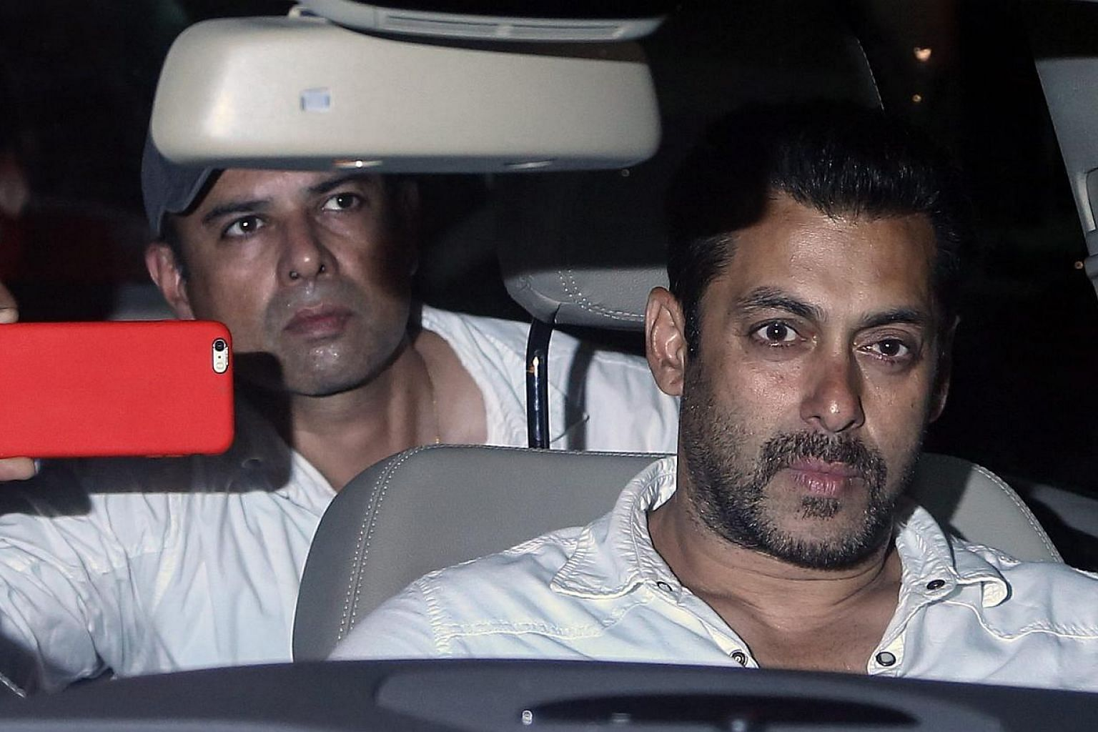 Salman Khan leaving court after getting two days' interim bail from Bombay High Court, in Mumbai, India, on May 6, 2015. -- PHOTO: EPA