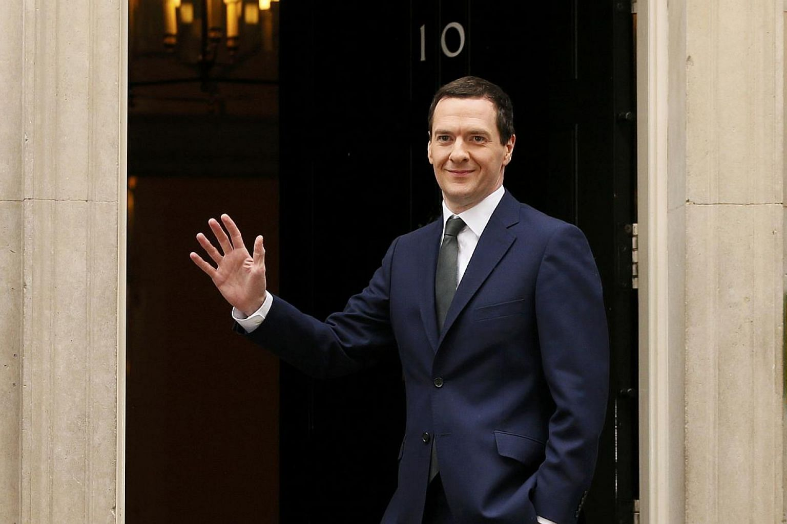 George Osborne arrives at 10 Downing Street as Britain's Prime Minister David Cameron begins to appoint his Cabinet after securing a majority goverment, in central London, May 8, 2015. -- PHOTO: REUTERS