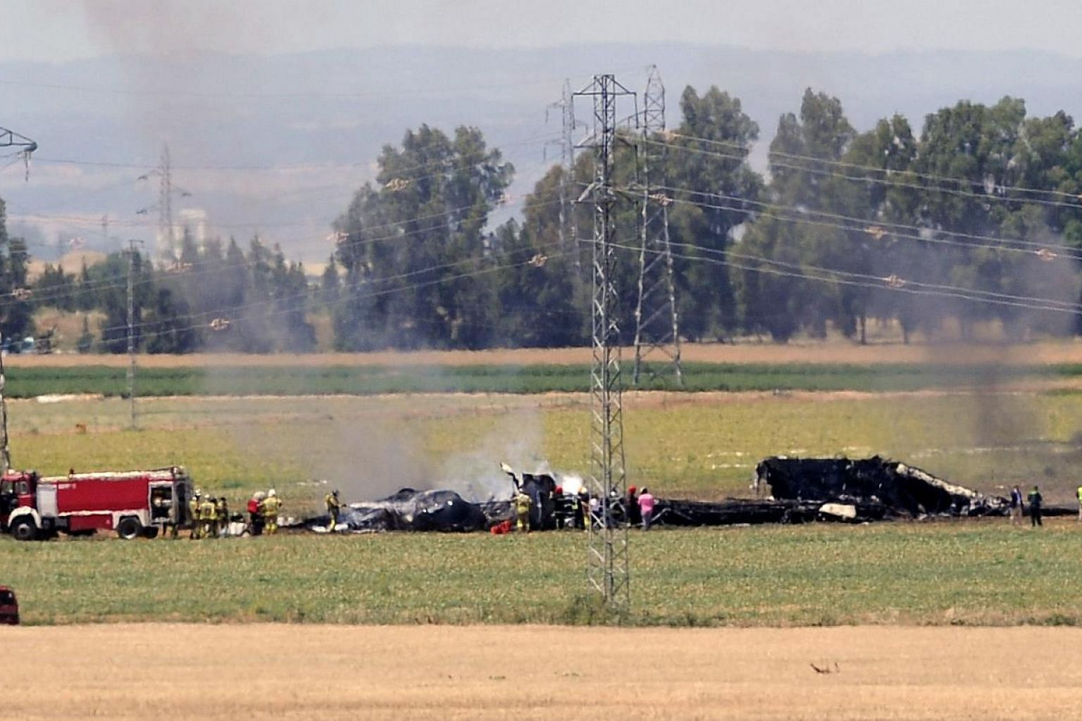 A view shows the wreckage of an Airbus A400M military transport plane after it crashed near Sevilla on May 9, 2015.Germany has grounded its Airbus A400M military transport aircraft after a similar plane crashed in Spain during a test flight on