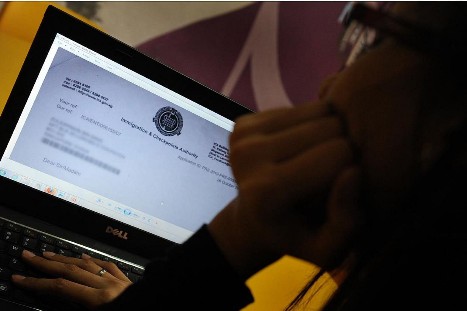 "An Immigration and Checkpoints Authority of Singapore (ICA) application form is seen on a laptop. Individuals who provide false information in their Singapore citizenship or permanent residency applications will be ""dealt with firmly"", says Second Mi"