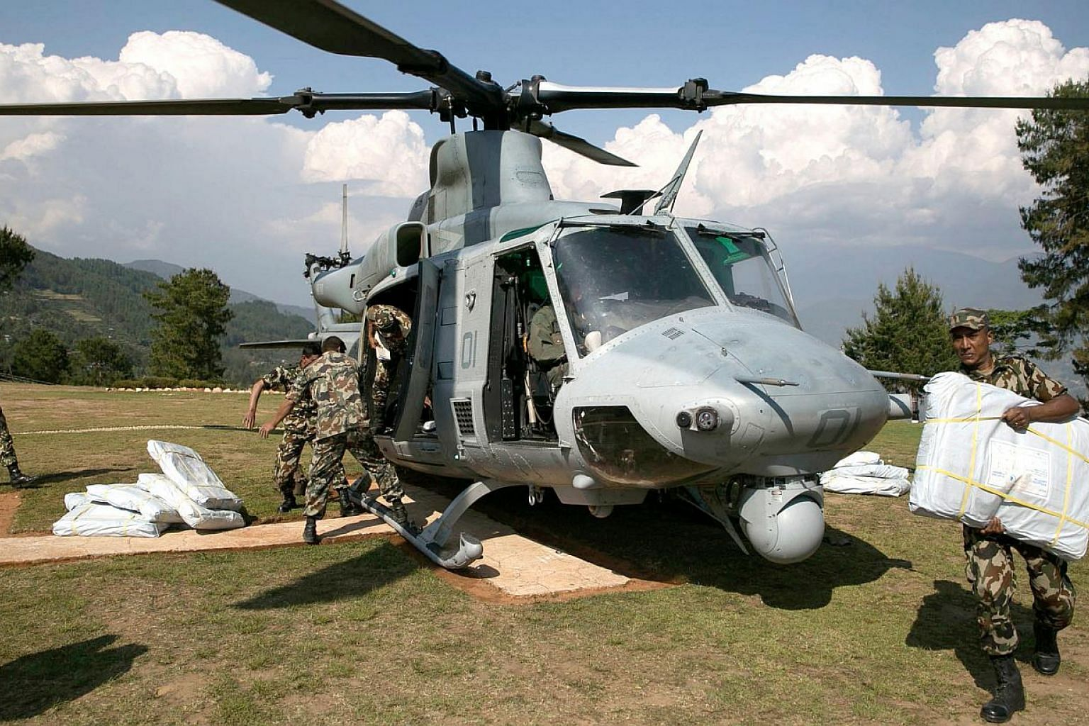 Nepali and United States troops were scouring the area worst-hit by a second large earthquake for a missing US Marine helicopter on Wednesday. -- PHOTO: AFP