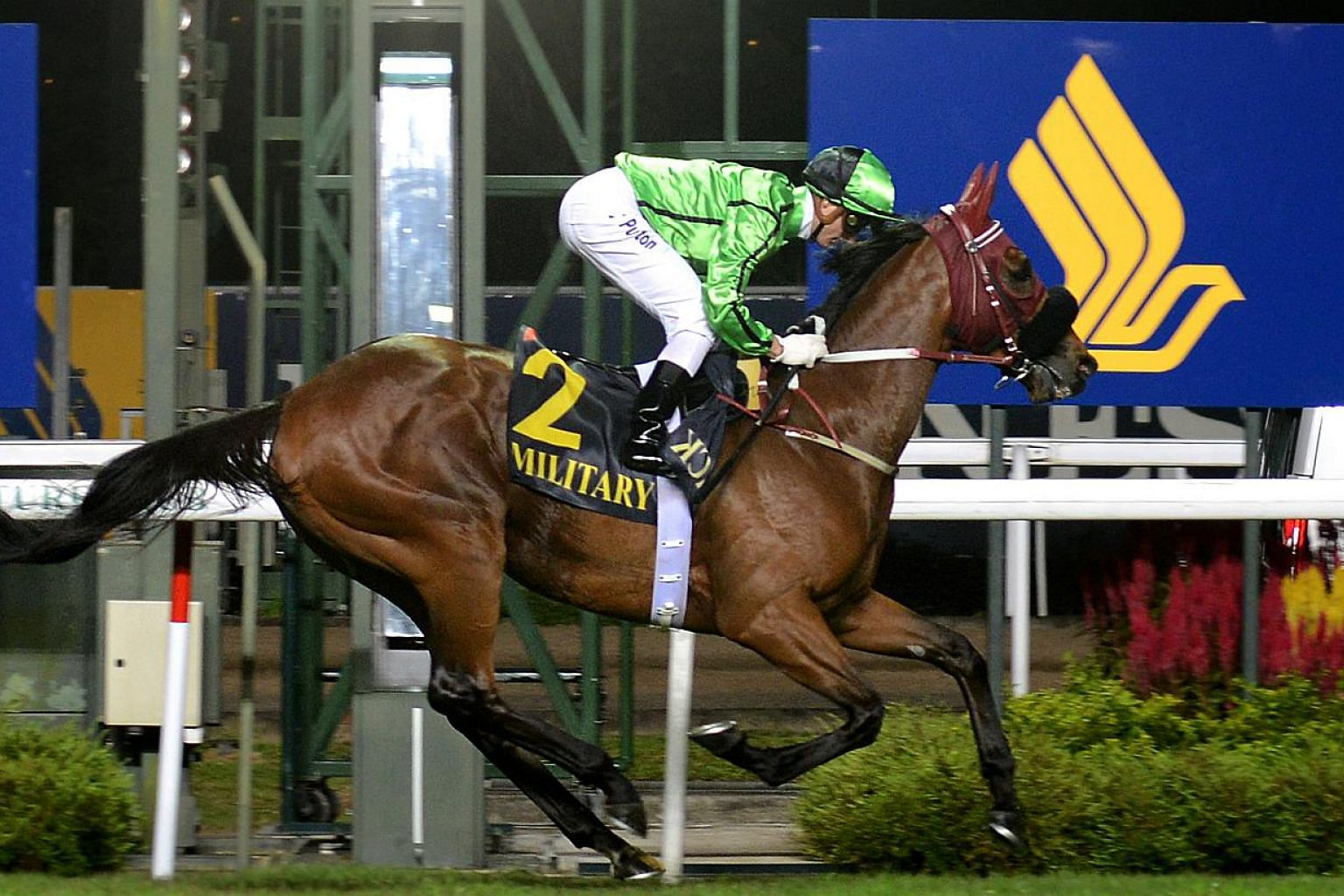 Race horse Military Attack (with jockey Zac Purton astride) emerged the champion of the Singapore Airlines International (SIA) Cup held at the Singapore Racecourse in Kranji on May 19, 2013. Military Attack will get to startin barrier 3 for the