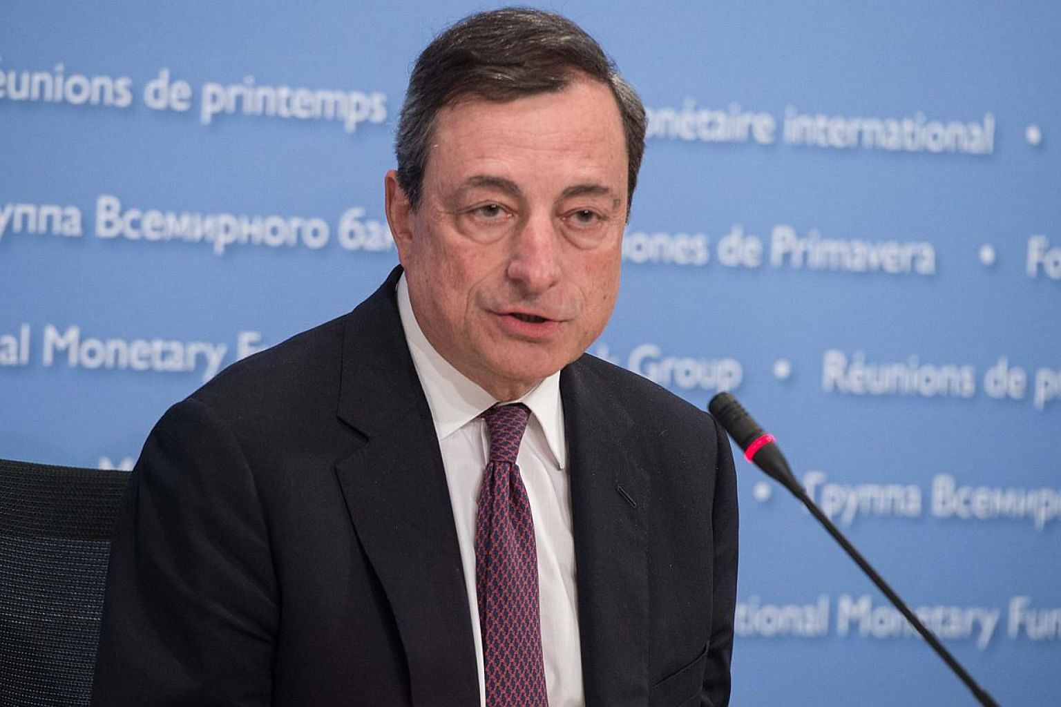 "European Central Bank President Mario Draghi said Thursday that the bank's massive stimulus for the eurozone will remain in force ""as long as needed"" to stabilize prices. -- PHOTO: AFP"