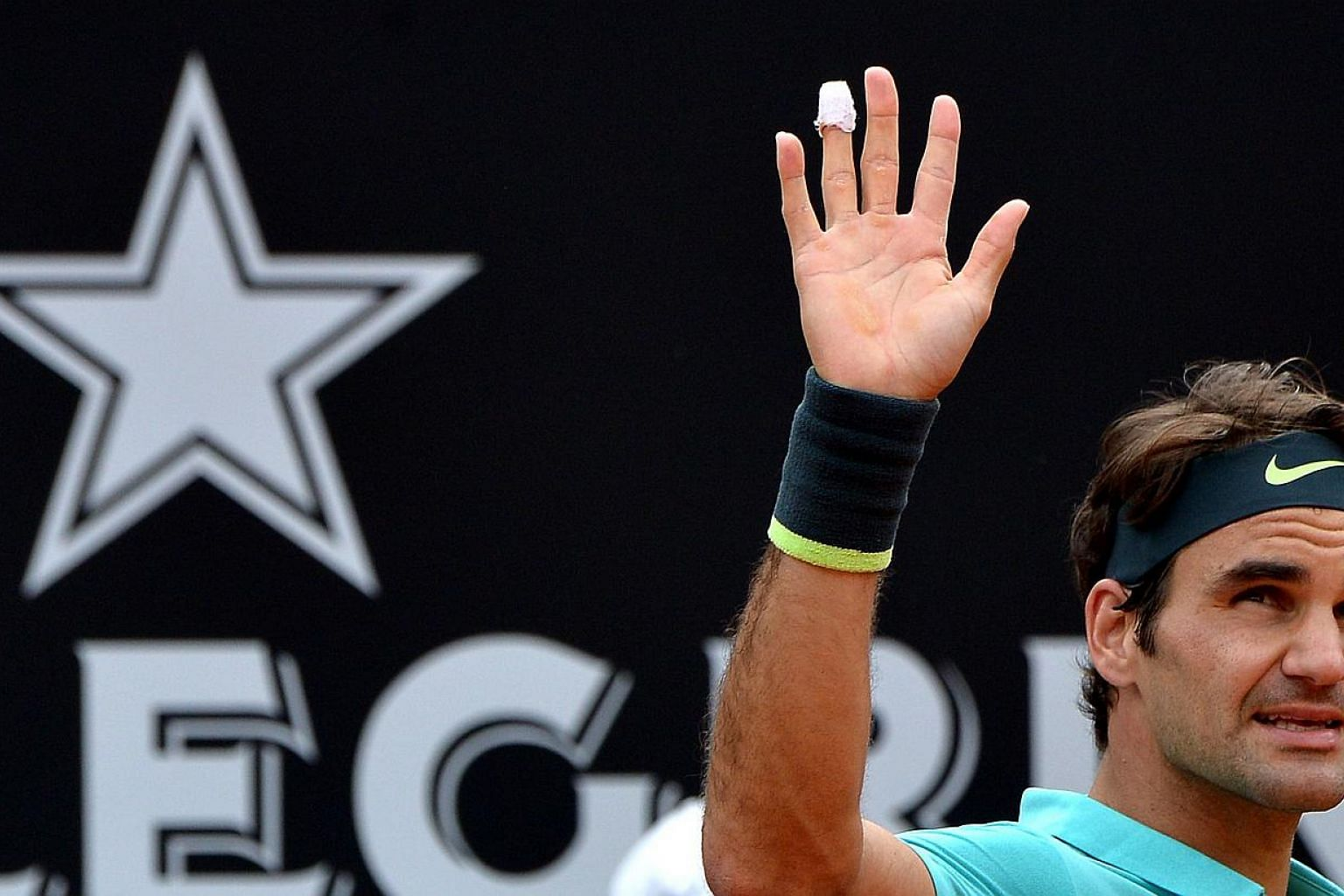 Swiss tennis player Roger Federer celebrates after winning against South African Kevin Anderson during the Italian Open on May 14, 2015 in Rome. -- PHOTO: AFP