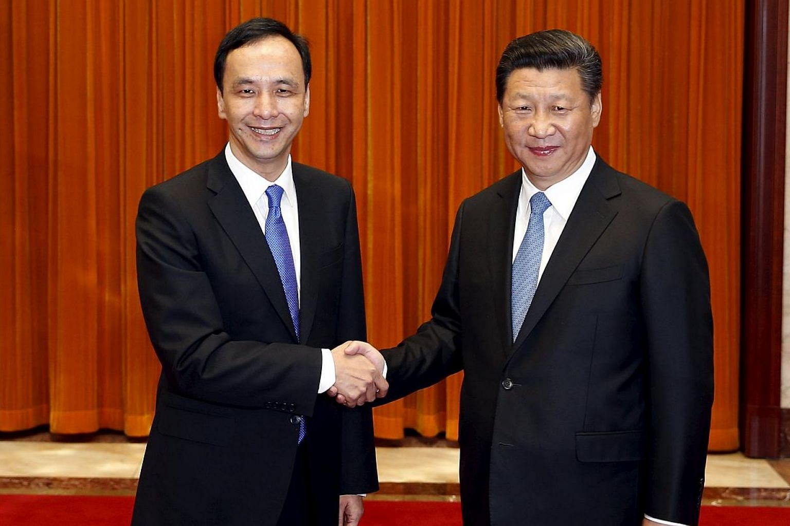 Chairman of Taiwan's ruling Nationalist Kuomintang Party (KMT) Eric Chu, also New Taipei mayor, shakes hands with China's President Xi Jinping as they pose for pictures during their meeting in Beijing, China on May 4, 2015. -- PHOTO: REUTERS