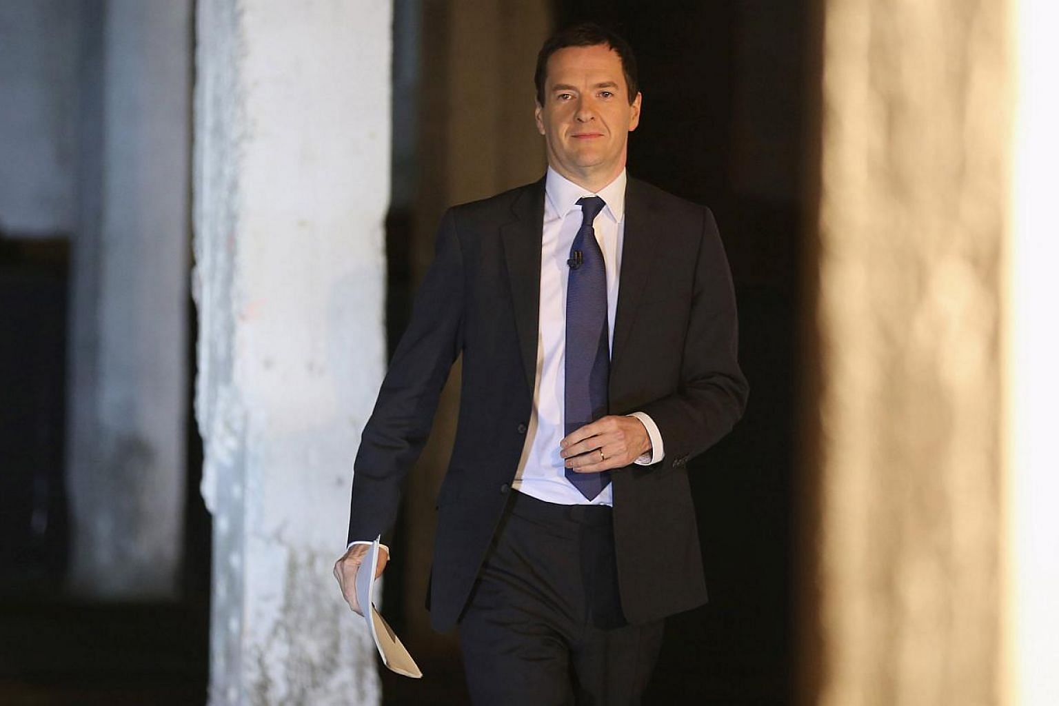 Britain's finance minister George Osborne announced plans for a second 2015 government budget on Saturday to quickly implement his Conservative Party's campaign promises of spending cuts and savings following a surprise election win. -- PHOTO: REUTER