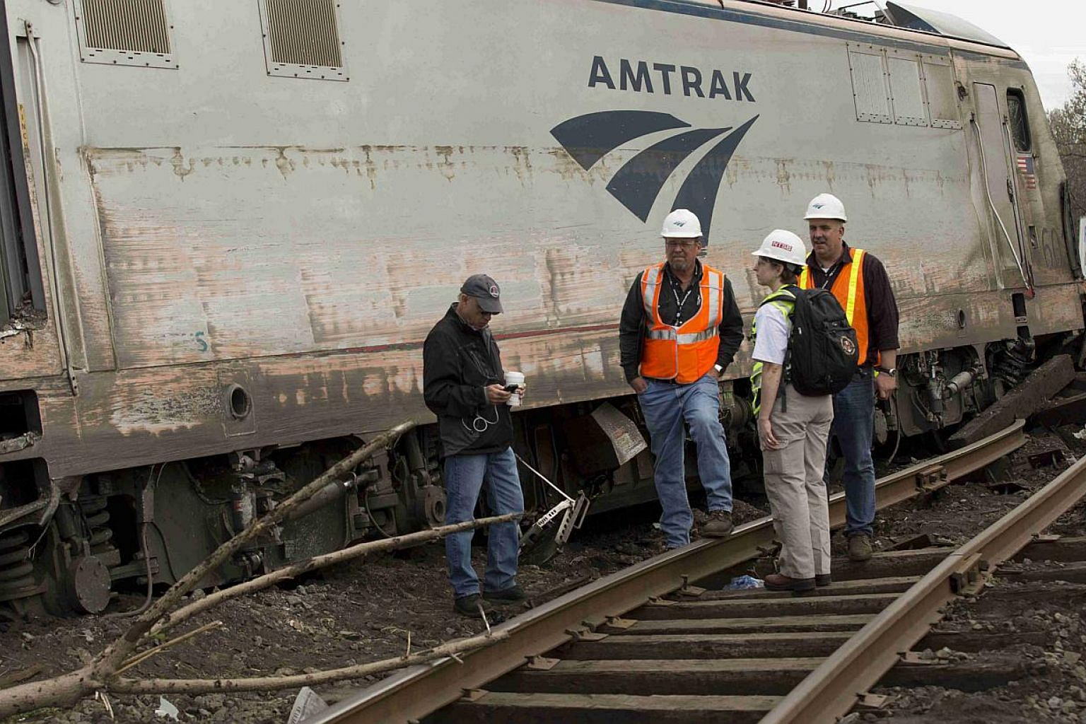 National Transportation Safety Board officials on the scene of the Amtrak derailment in Philadelphia on May 13, 2015. The train and a separate commuter train in the vicinity may have been hit by projectiles of some kind shortly before the wreck, a US