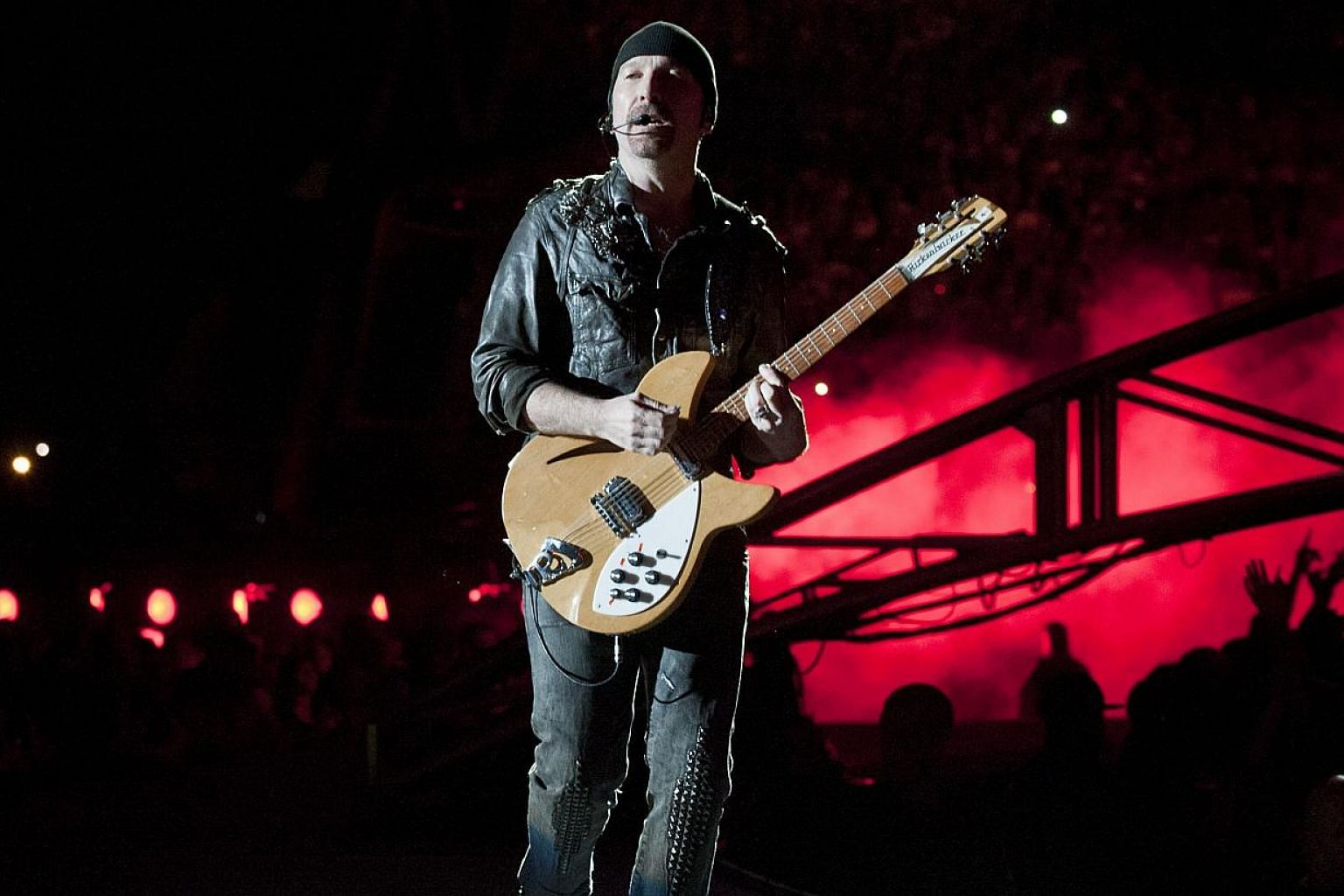 U2 guitarist The Edge (above, in a 2011 file photo) apparently did not see the part of the stage that is his own namesake as he tumbled on the first night of the veteran Irish rockers' tour. -- PHOTO: AFP