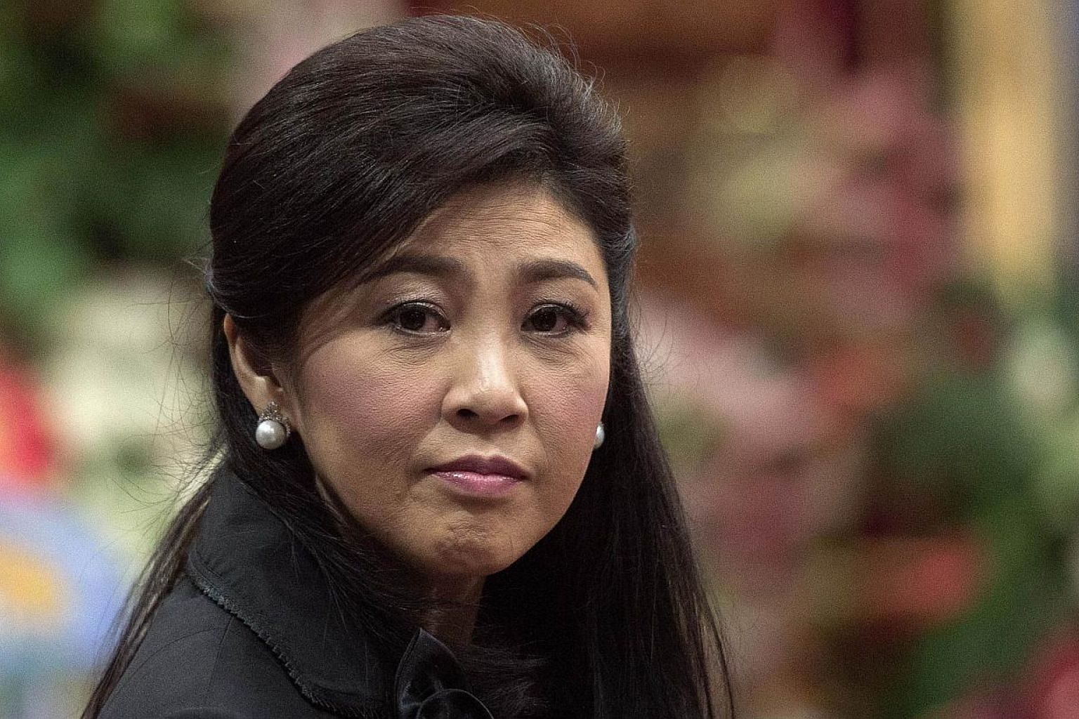 Thailand's first female prime minister Yingluck Shinawatra (above) is expected to appear in court today for the start of a negligence trial which could see her jailed for a decade. -- PHOTO: AFP