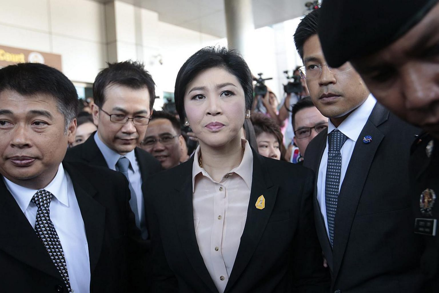 Former Thai prime minister Yingluck Shinawatra (centre) leaving the Supreme Court in Bangkok, Thailand, on May 19, 2015. -- PHOTO: EPA