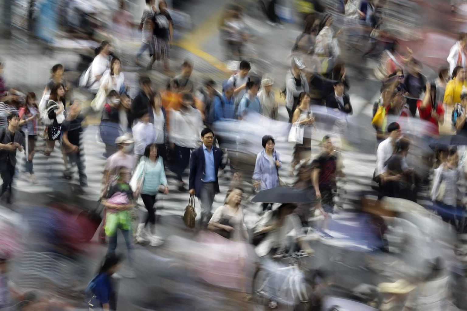 Japan's economy grew at its fastest pace in a year in January-March on modest increases in consumption and capital expenditure, adding to evidence the country is steadily emerging from last year's recession. -- PHOTO: EPA