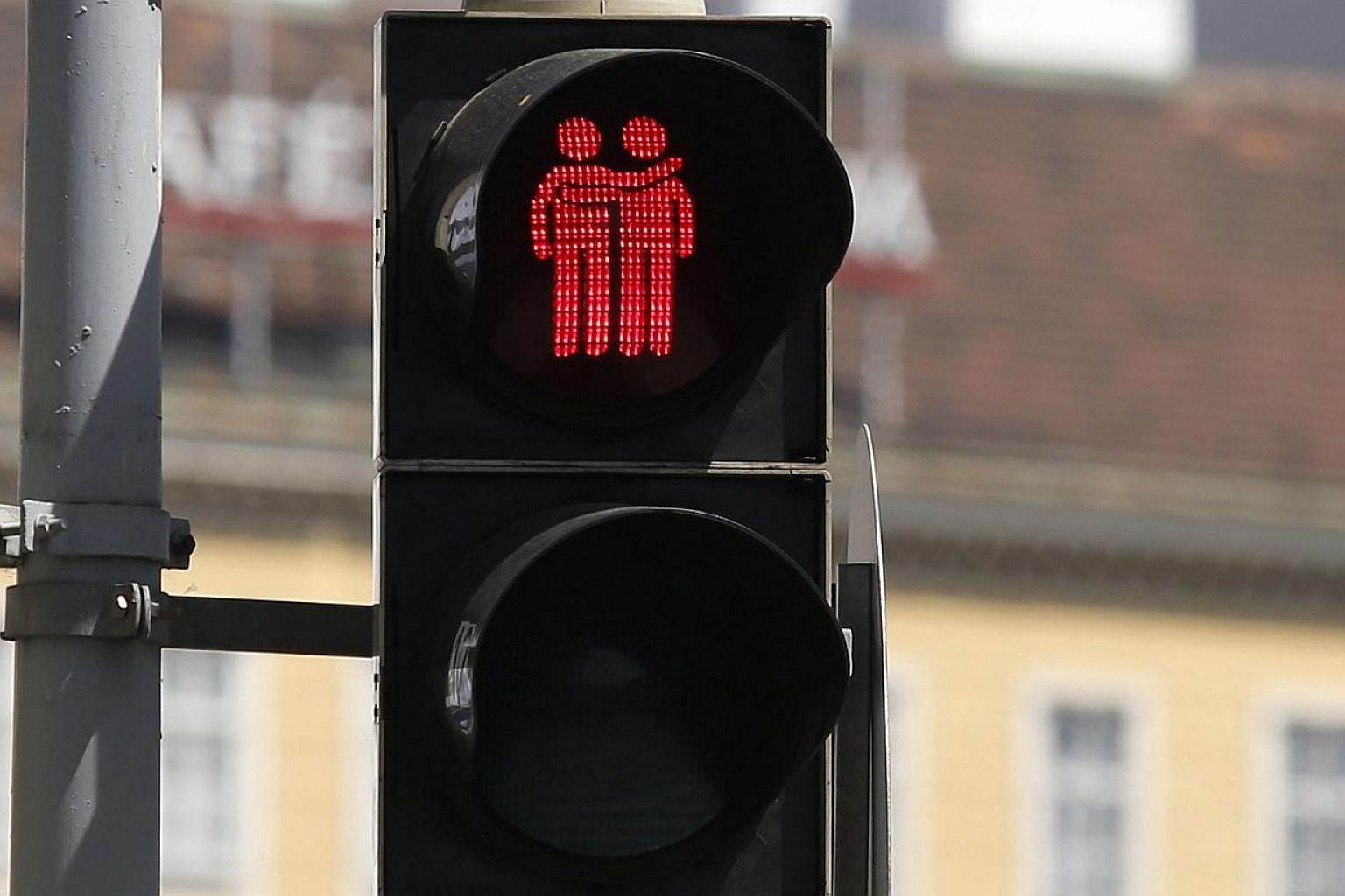 A new traffic light, showing a same-sex couple, is pictured on May 12, 2015 in Vienna.Gay-themed traffic lights installed in Vienna for the 2015 Eurovision Song Contest have proven so popular that authorities have now decided to keep them for g