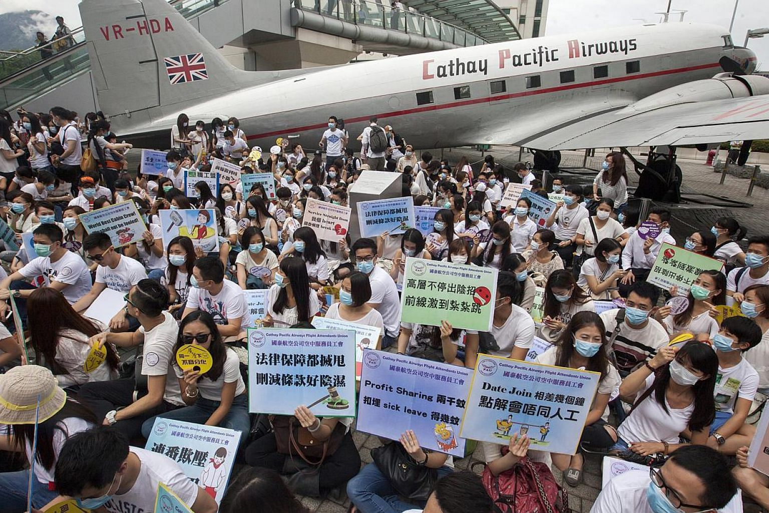 Flight attendants from Hong Kong's flag carrier airline Cathay Pacific stage a pay protest outside Cathay Pacific's management headquarters at Cathay City, Lantau Island, Hong Kong, China onMay 21,2015. The Cathay Pacific Airways flight a
