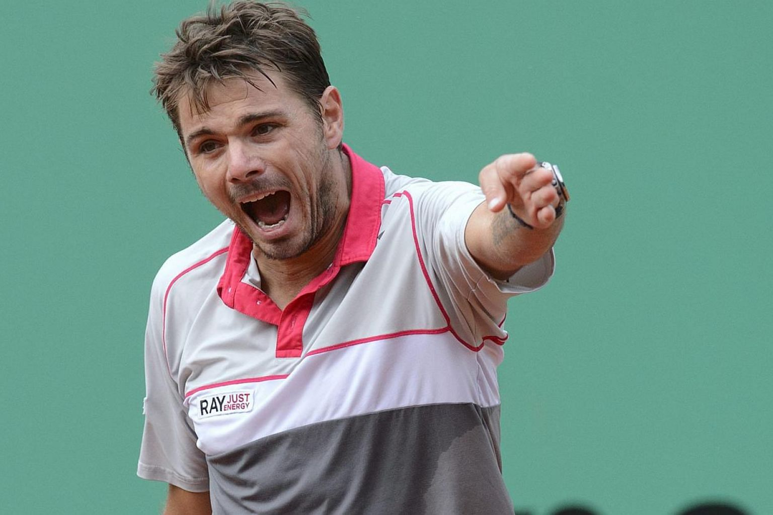 Switzerland's Stan Wawrinka reacts after losing a point to Lukas Rosol of the Czech Republic in the Geneva Open on May 20, 2015. -- PHOTO: EPA
