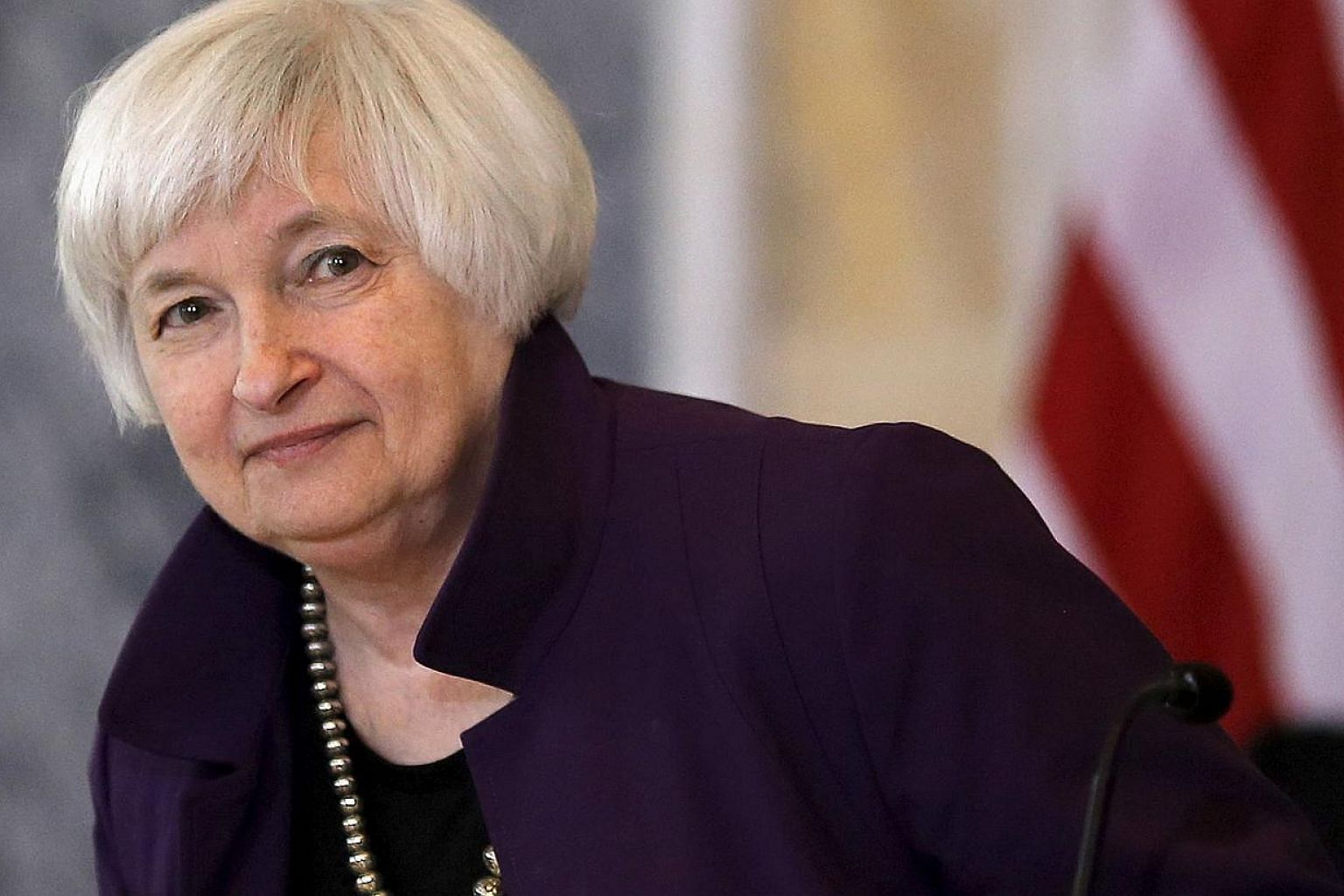 "Janet Yellen (above) said Friday she expects the Federal Reserve to begin raising interest rates ""at some point this year,"" saying delaying the long-awaited move risks the economy overheating. -- PHOTO: REUTERS"