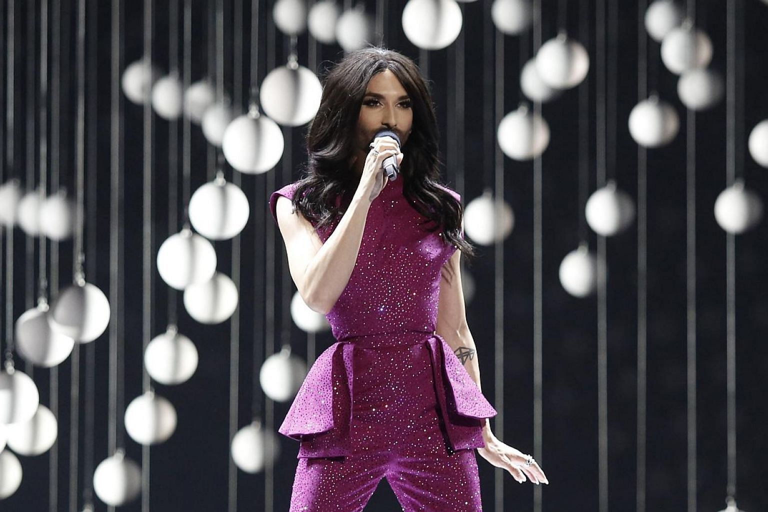 Last year's winner, Conchita Wurst from Austria, performs during the Eurovision Song Contest final on May 23, 2015 in Vienna. -- PHOTO: AFP