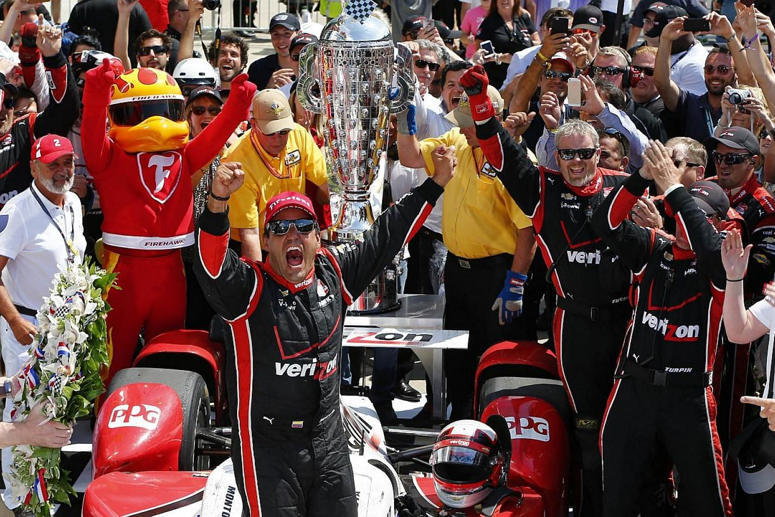Juan Pablo Montoya of Colombia, driver of the #2 Team Penske Chevrolet Dallara celebrates after winning the 99th running of the Indianapolis 500 mile race at the Indianapolis Motor Speedway on May 24, 2015 in Indianapolis, Indiana. -- PHOTO: AFP